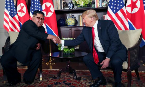 With handshakes, smiles and a thumbs up, Trump and Kim start historic summit