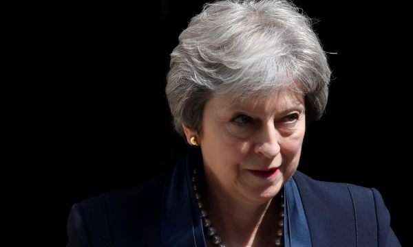 May 'disappointed' after colleague blocks 'upskirting' law