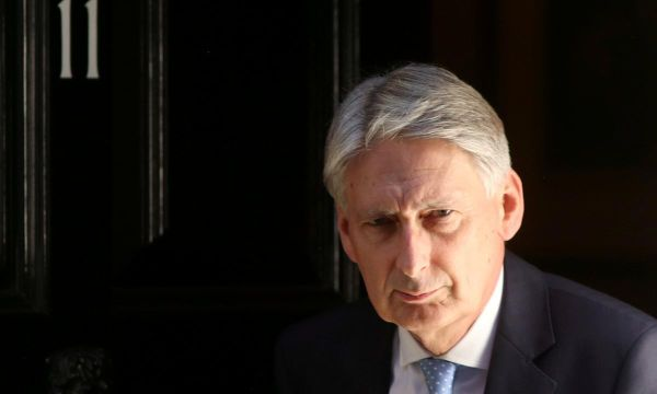 Conservatives split again by Hammond's Brexit warning