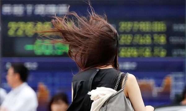 Asian shares on slippery slope as trade tensions take toll