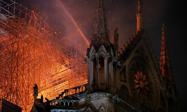 Blaze devastates Notre-Dame; Paris firefighters fear for one bell tower