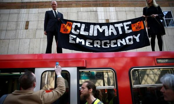 Climate-change protesters disrupt London docklands train service