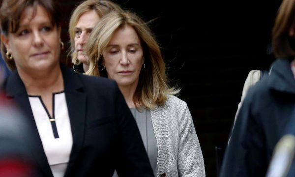 Tearful Felicity Huffman admits role in U.S. college admissions scandal