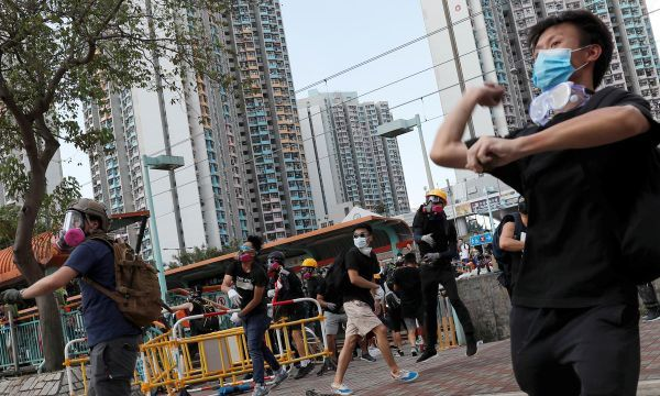 Hong Kong police fire tear gas as strikes paralyze city